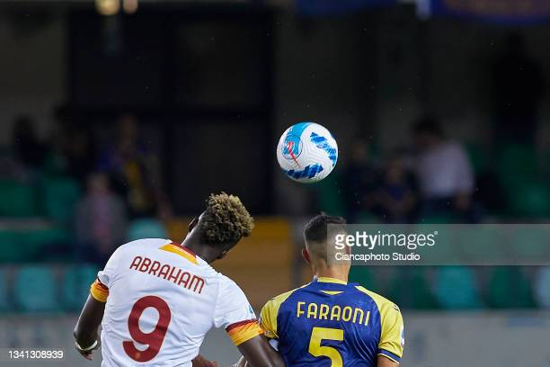 Tammy Abraham of AS Roma competes for the ball with Davide Faraoni of Hellas Verona FC during the Serie A match between Hellas and AS Roma at Stadio...