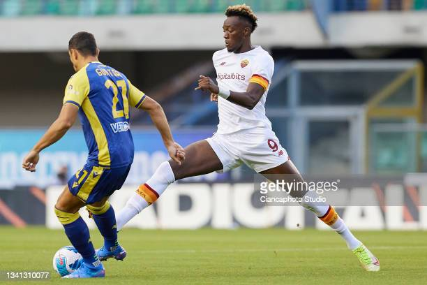 Tammy Abraham of AS Roma competes for the ball with Koray Gunter of Hellas Verona FC during the Serie A match between Hellas and AS Roma at Stadio...