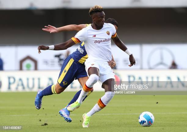 Tammy Abraham of AS Roma is challenged by Koray Guenter of Hellas Verona during the Serie A match between Hellas and AS Roma at Stadio Marcantonio...