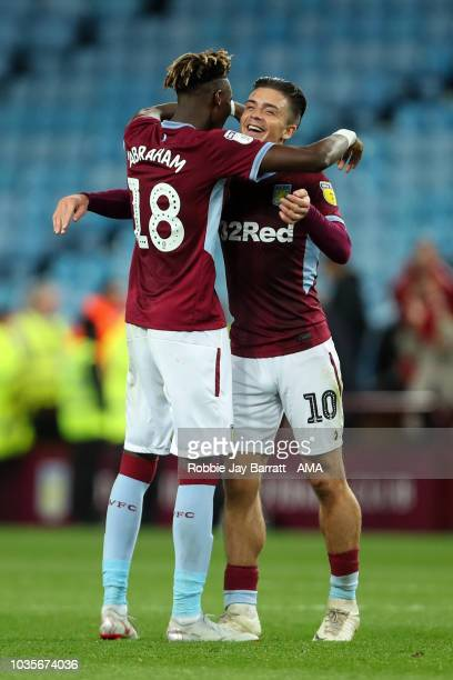 Tammy Abraham of Aston Villa and Jack Grealish of Aston Villa celebrate art full time during the Sky Bet Championship match at Villa Park on...