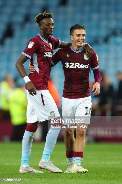Tammy Abraham of Aston Villa and Jack Grealish of Aston Villa celebrate at full time during the Sky Bet Championship match at Villa Park on September...