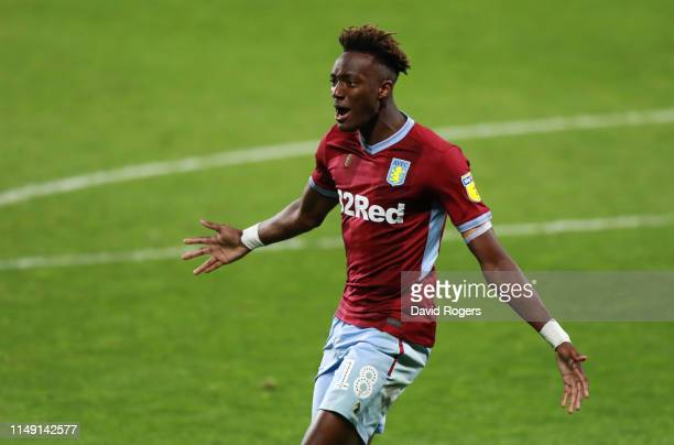 Tammy Abraham of Aston Villa celebrates as he scores the winning penalty in the shoot out during the Sky Bet Championship Play-off semi final second...