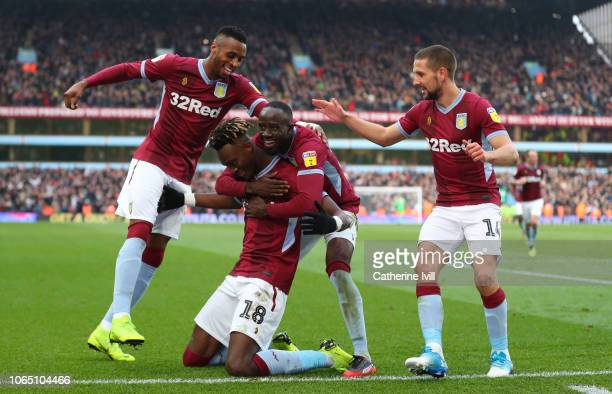 Tammy Abraham of Aston Villa celebrates with his team mates after he scores his teams third goal from the penalty spot during the Sky Bet...