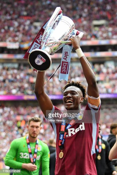 Tammy Abraham of Aston Villa celebrates with the trophy following his teams victory in the Sky Bet Championship Playoff Final match between Aston...