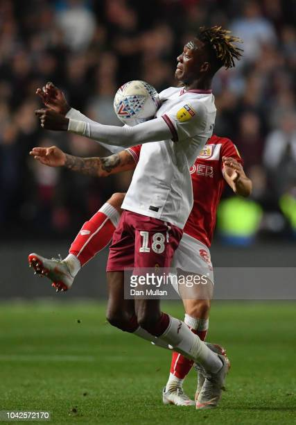 Tammy Abraham of Aston Villa is challenged by Josh Brownhill of Bristol City during the Sky Bet Championship match between Bristol City and Aston...