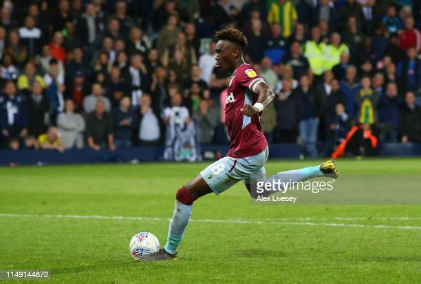 Tammy Abraham of Aston Villa scores the winning penalty in the shoot out during the Sky Bet Championship Play-off semi final second leg match between...