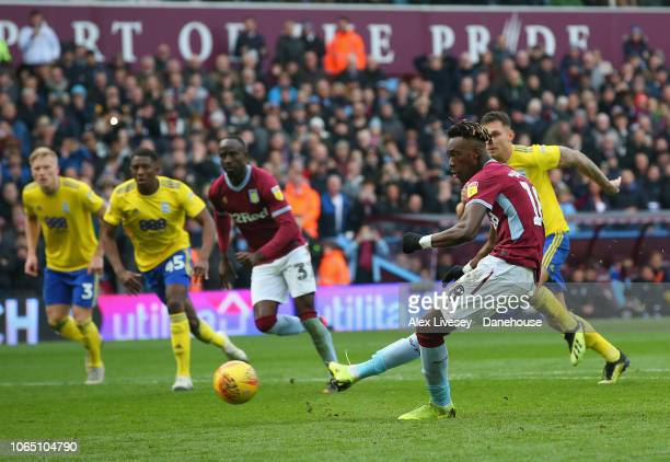 Tammy Abraham of Aston Villa scores their third goal from the penalty spot during the Sky Bet Championship match between Aston Villa and Birmingham...