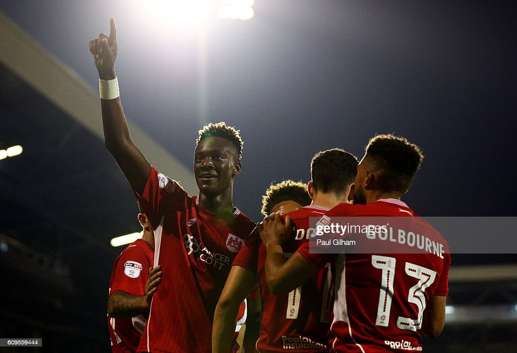 Tammy Abraham of Bristol City celebrates scoring his sides second goal with team mates during the EFL Cup Third Round match between Fulham and Bristol City at Craven Cottage on September 21, 2016 in London, England.