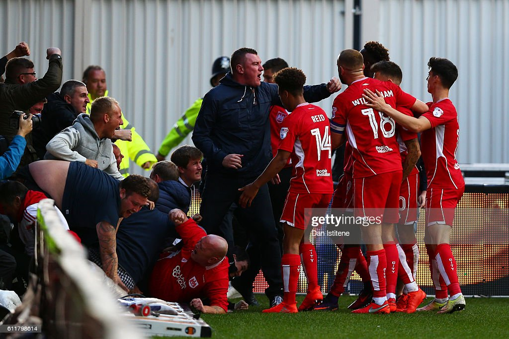 Tammy Abraham of Bristol City celebrates with fans and his team-mates after scoring his team's first goal during the Sky Bet Championship match between Bristol City and Nottingham Forest at Ashton Gate on October 1, 2016 in Bristol, England.
