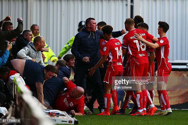 Tammy Abraham of Bristol City celebrates with fans and his teammates after scoring his team's first goal during the Sky Bet Championship match...