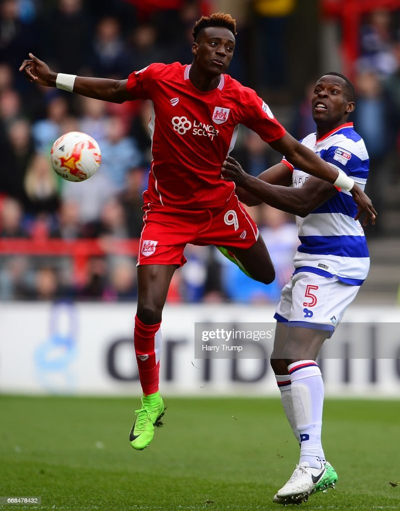 Tammy Abraham of Bristol City challenges for the high ball with Nedum Onuoha of Queens Park Rangers during the Sky Bet Championship match between Bristol City and Queens Park Rangers at Ashton Gate on April 14, 2017 in Bristol, England.
