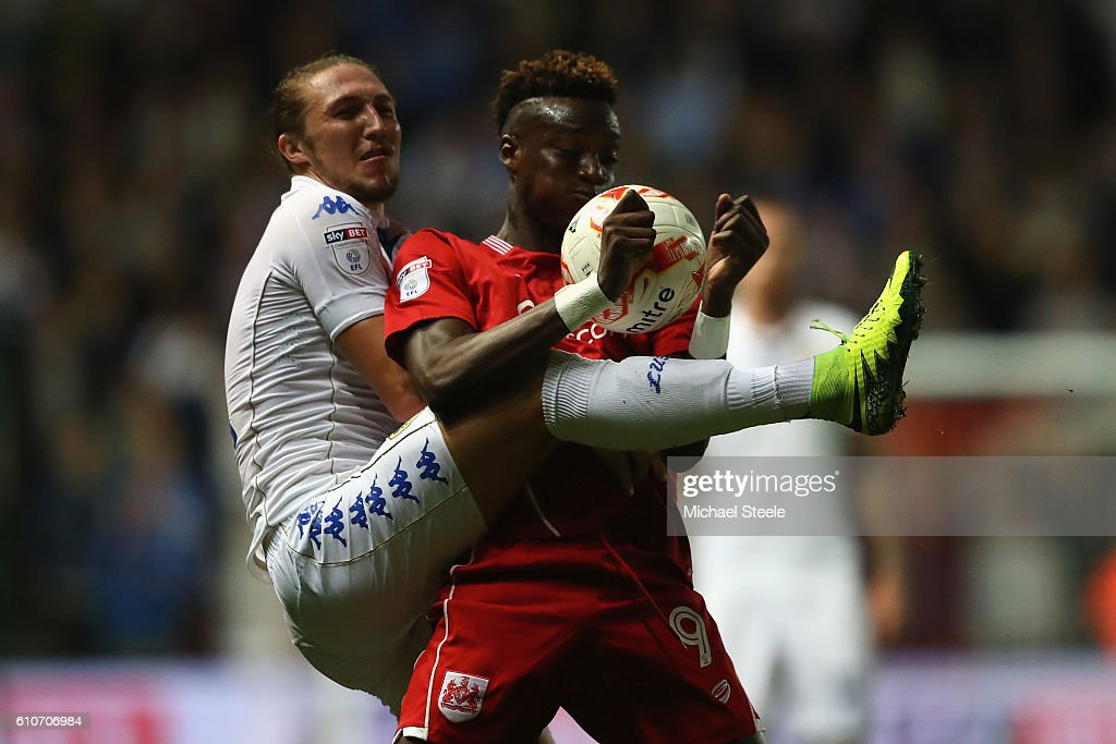 Tammy Abraham (R) of Bristol City is challenged by Luke Ayling of Leeds United during the Sky Bet Championship match between Bristol City and Leeds United at Ashton Gate on September 27, 2016 in Bristol, England.