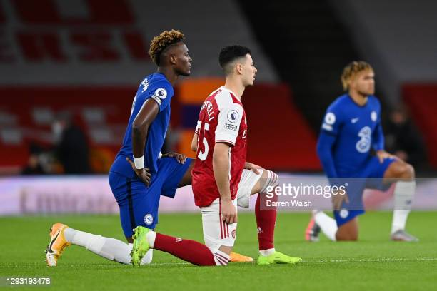 Tammy Abraham of Chelsea and Gabriel Martinelli of Arsenal takes a knee in support of the Black Lives Matter Movement prior to the Premier League...
