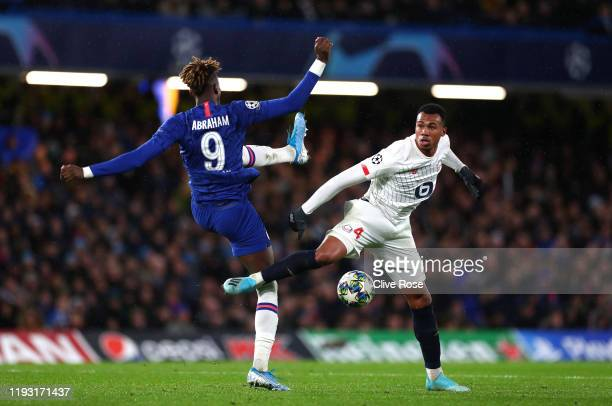 Tammy Abraham of Chelsea and Gabriel of Lille during the UEFA Champions League group H match between Chelsea FC and Lille OSC at Stamford Bridge on...