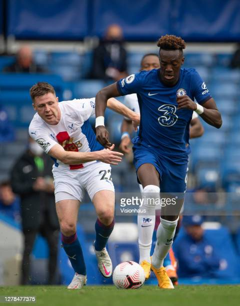 Tammy Abraham of Chelsea and James McCarthy of Crystal Palace during the Premier League match between Chelsea and Crystal Palace at Stamford Bridge...