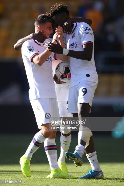 Tammy Abraham of Chelsea and Mason Mount of Chelsea celebrate following their sides victory in the Premier League match between Wolverhampton...