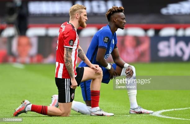 Tammy Abraham of Chelsea and Oliver McBurnie of Sheffield United take a knee in support of the Black Lives Matter movement prior to the Premier...