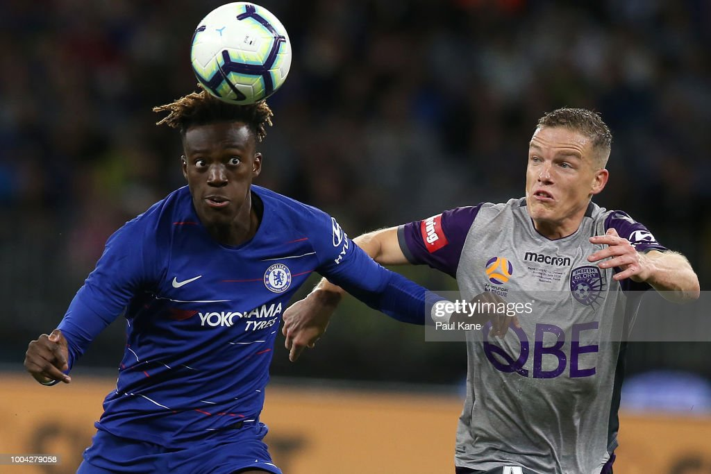 Tammy Abraham of Chelsea and Shane Lowry of the Glory contest fot the ball during the international friendly between Chelsea FC and Perth Glory at Optus Stadium on July 23, 2018 in Perth, Australia.