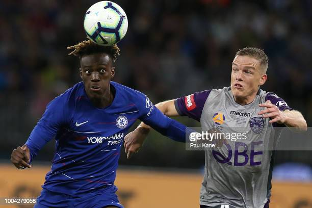 Tammy Abraham of Chelsea and Shane Lowry of the Glory contest fot the ball during the international friendly between Chelsea FC and Perth Glory at...