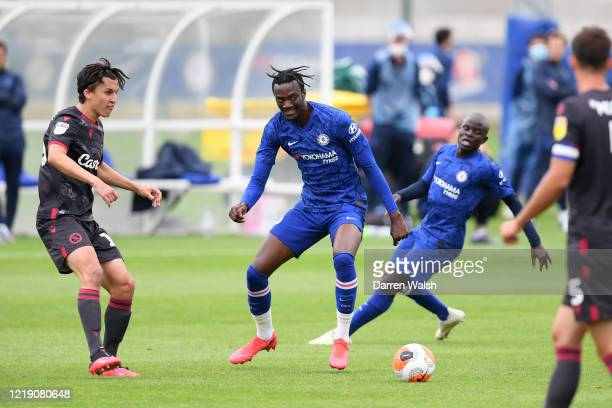 Tammy Abraham of Chelsea and Tom McIntyre of Reading during a friendly match between Chelsea and Reading at Cobham Training ground on June 10, 2020...