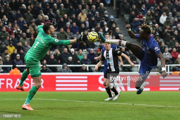 Tammy Abraham of Chelsea attempts to knock the ball past Martin Dubravka of Newcastle United during the Premier League match between Newcastle United...