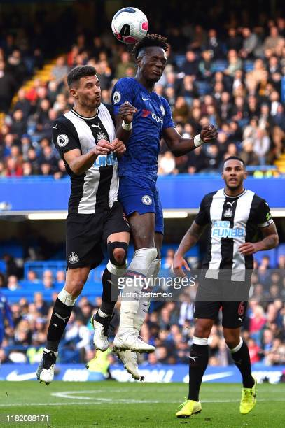 Tammy Abraham of Chelsea battles for possession with Fabian Schar of Newcastle United during the Premier League match between Chelsea FC and...