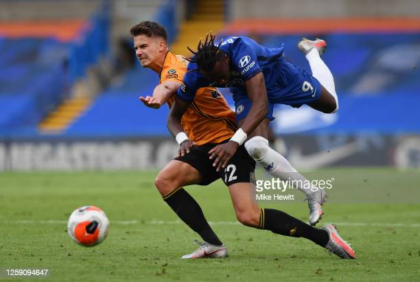 Tammy Abraham of Chelsea battles for possession with Leander Dendoncker of Wolverhampton Wanderers during the Premier League match between Chelsea FC...