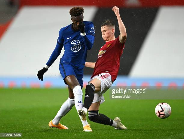 Tammy Abraham of Chelsea battles for possession with Scott McTominay of Manchester United during the Premier League match between Manchester United...