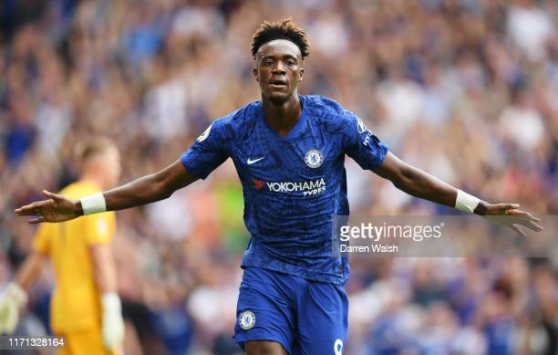 Tammy Abraham of Chelsea celebrates after scoring his team's first goal during the Premier League match between Chelsea FC and Sheffield United at...