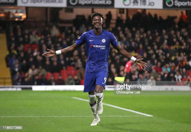 Tammy Abraham of Chelsea celebrates after scoring his team's first goal during the Premier League match between Watford FC and Chelsea FC at Vicarage...