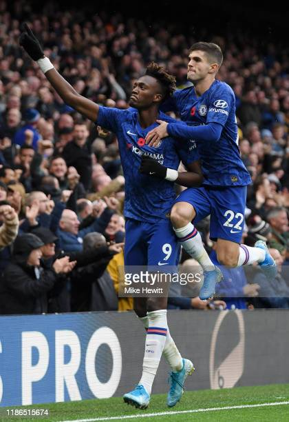 Tammy Abraham of Chelsea celebrates after scoring his team's first goal with teammate Christian Pulisic during the Premier League match between...