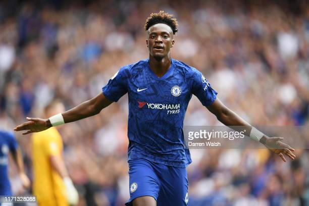 Tammy Abraham of Chelsea celebrates after scoring his team's fist goal during the Premier League match between Chelsea FC and Sheffield United at...