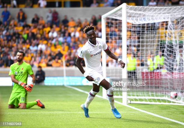 Tammy Abraham of Chelsea celebrates after scoring his team's fourth goal during the Premier League match between Wolverhampton Wanderers and Chelsea...