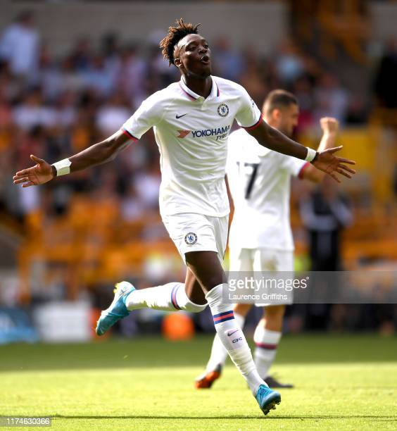 Tammy Abraham of Chelsea celebrates after scoring his team's second goal during the Premier League match between Wolverhampton Wanderers and Chelsea...