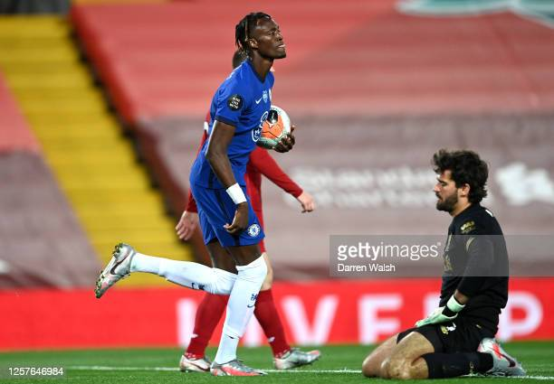 Tammy Abraham of Chelsea celebrates after scoring his team's second goal as Alisson Becker of Liverpool reacts during the Premier League match...