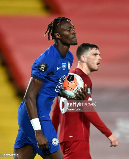 Tammy Abraham of Chelsea celebrates after scoring his team's second goal during the Premier League match between Liverpool FC and Chelsea FC at...