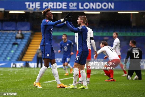 Tammy Abraham of Chelsea celebrates after scoring their sides first goal with team mate Timo Werner during The Emirates FA Cup Fourth Round match...
