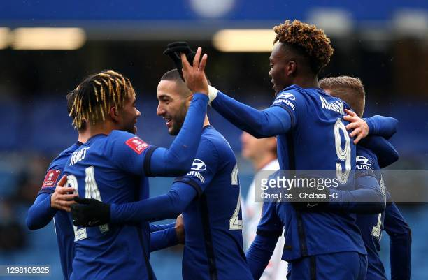 Tammy Abraham of Chelsea celebrates after scoring their sides first goal with team mates Reece James, Hakim Ziyech and Timo Werner during The...