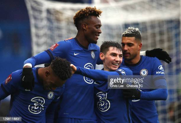 Tammy Abraham of Chelsea celebrates after scoring their sides third goal with team mates Callum Hudson-Odoi, Billy Gilmour and Emerson during The...