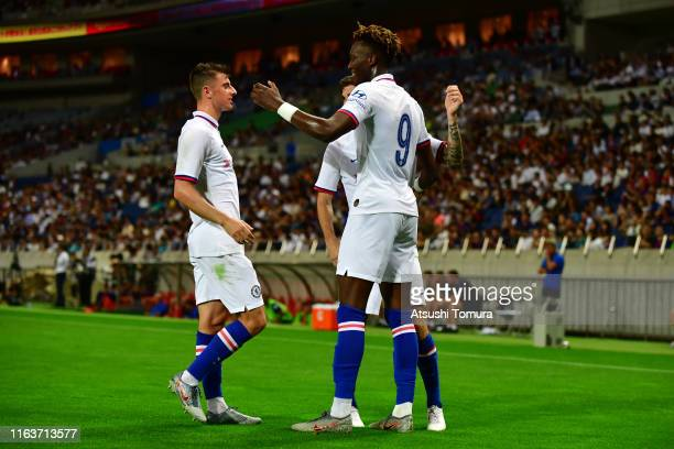 Tammy Abraham of Chelsea celebrates scoring his side's first goal with his team mates during the preseason friendly match between Barcelona and...