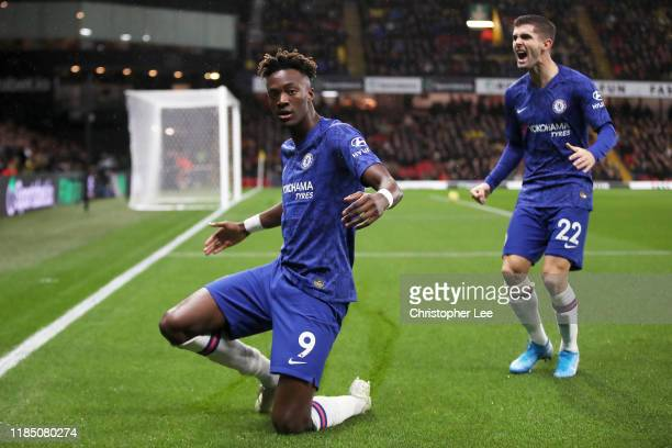 Tammy Abraham of Chelsea celebrates with Christian Pulisic after scoring his team's first goal during the Premier League match between Watford FC and...