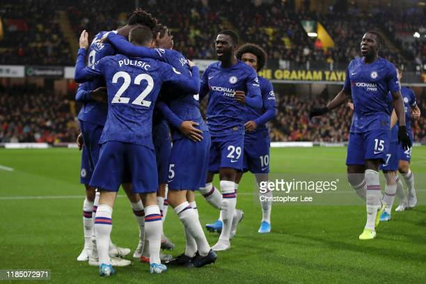 Tammy Abraham of Chelsea celebrates with his team mates after scoring his team's first goal during the Premier League match between Watford FC and...