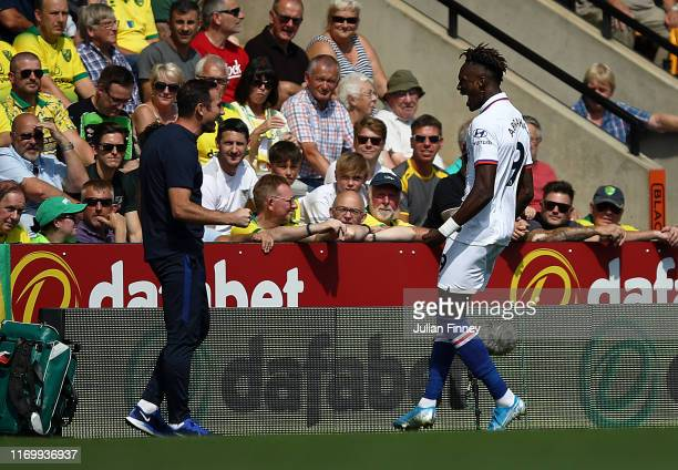 Tammy Abraham of Chelsea celebrates with manager Frank Lampard after he scored the first goal during the Premier League match between Norwich City...