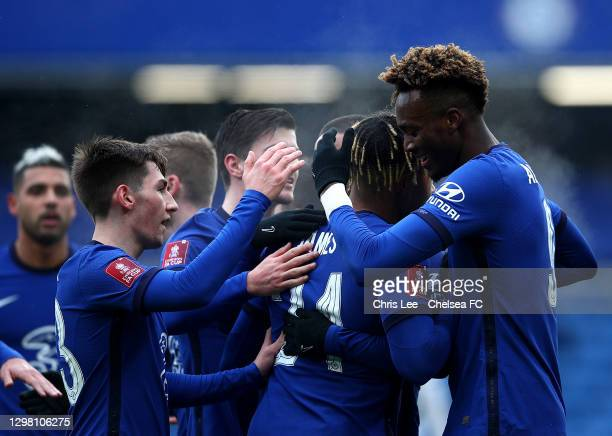Tammy Abraham of Chelsea celebrates with team mates Billy Gilmour and Reece James after scoring their side's second goal during The Emirates FA Cup...
