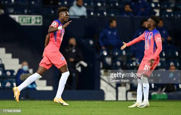 Tammy Abraham of Chelsea celebrates with teammate Callum Hudson-Odoi after scoring his sides third goal during the Premier League match between West...