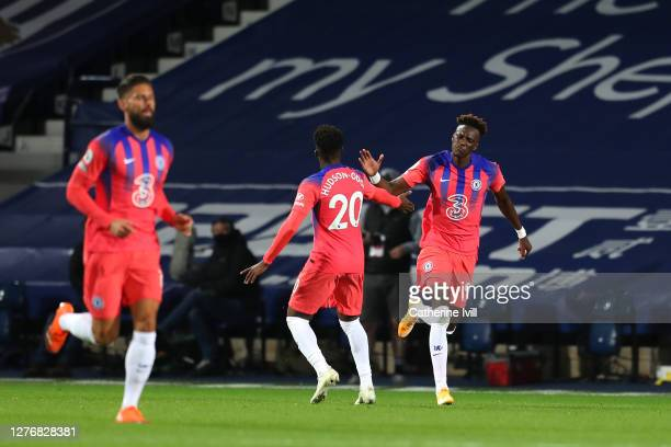 Tammy Abraham of Chelsea celebrates with teammate Callum HudsonOdoi after scoring his sides third goal during the Premier League match between West...
