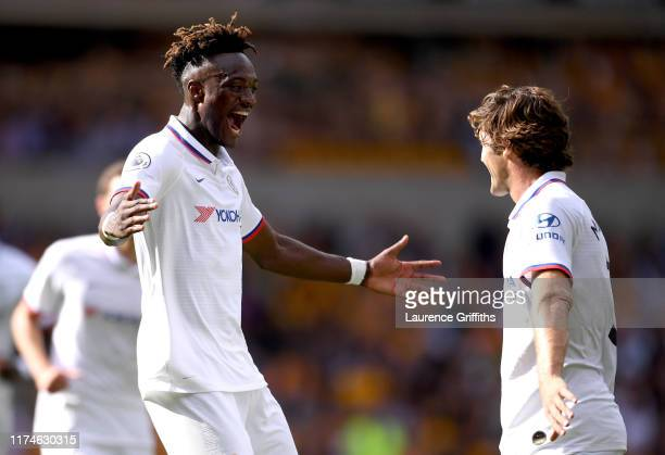 Tammy Abraham of Chelsea celebrates with teammate Marcos Alonso after scoring his team's second goal during the Premier League match between...