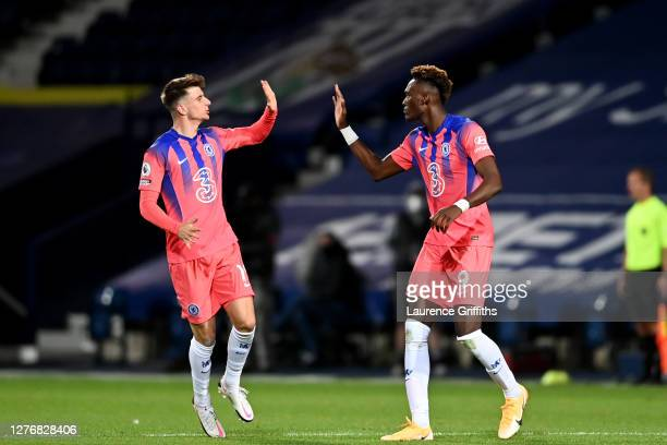 Tammy Abraham of Chelsea celebrates with teammate Mason Mount after scoring his sides third goal during the Premier League match between West...