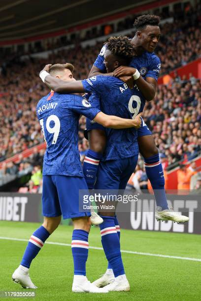 Tammy Abraham of Chelsea celebrates with teammates after scoring his team's first goal during the Premier League match between Southampton FC and...