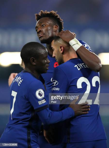 Tammy Abraham of Chelsea celebrates with teammates after scoring his team's first goal during the Premier League match between Chelsea and Sheffield...